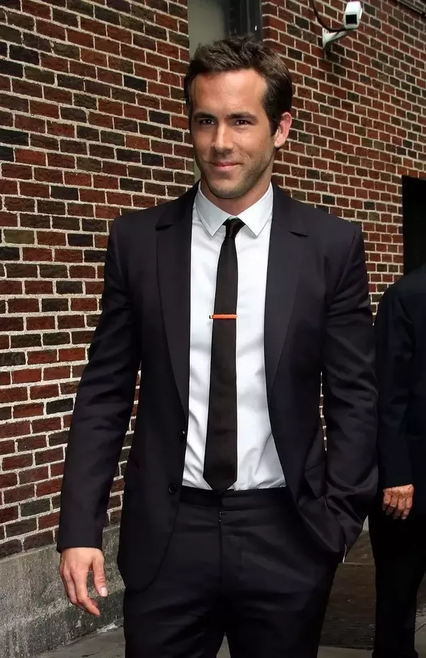 All suit black and white tie