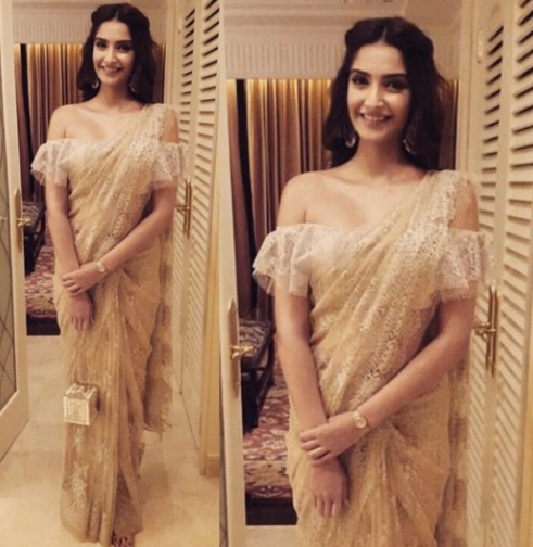 9c8d221c359 You could even go for a more modern look with a loose-fitted crop top and a  saree draped dhoti style, or with a loosely done pallu to get Sonam's  stunning ...
