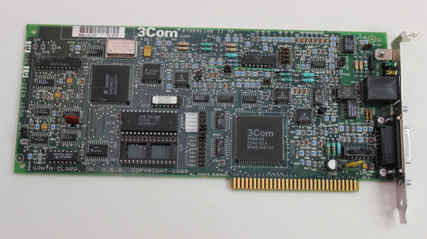 In This Member Of Venerable 3Com 3C503 Ethernet Card Family The MAC Address Lives On Chip With White Sticker Situated Below Logo