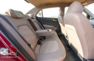 In Hyundai Xcent Is It Possible To Seat Three Average Adults To Sit
