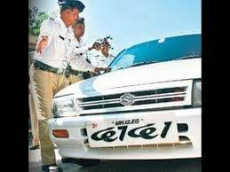 Company staff at Burari fitting Delhi's first high security number plate