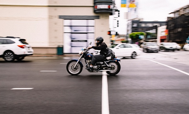 When you shift to a higher gear in a motorcycle, why does the RPM