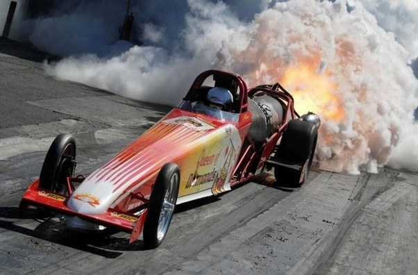 Why do jet drag cars use wide slick tires? - Quora