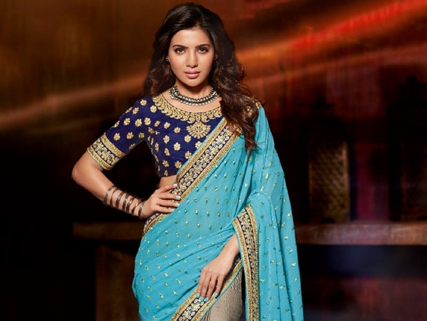 ffbd571c28e22 Blue blouse- You can never go wrong with this blouse design. Especially if  your saree is heavily embellished