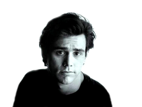 Jim Carrey smiling into camera with a black and white tone on the image.
