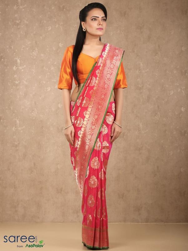 b10ffa6cdaca2 Banarasi silk saris are brocade drapes woven in the handlooms of Varanasi.  The details are inspired by nature and have traces of Mughal art. Banarasi  sarees ...