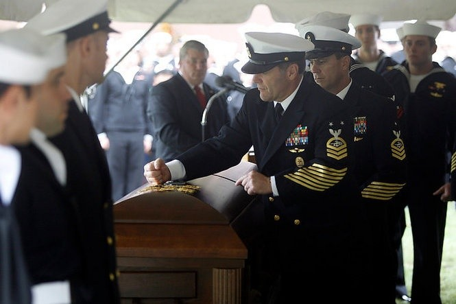 What is the significance of a fellow sailor pounding a Navy
