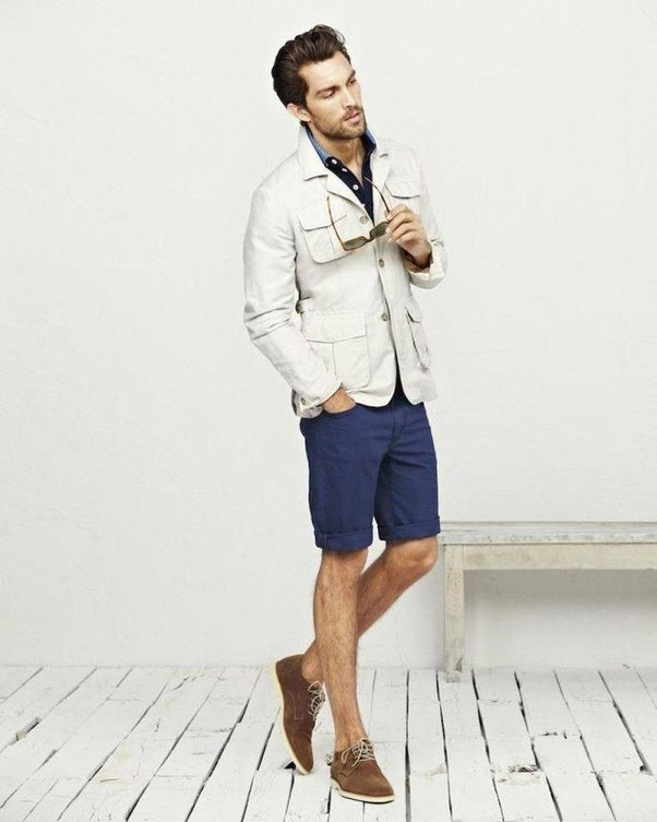Navy Blue Shorts With A Jacket Over An Off White Shirt Pinkish Hue The Black Suspenders Shoes And Portfolio Pull