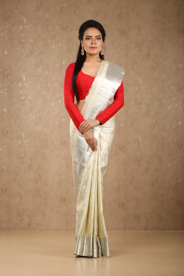 b9d986d3ed405a An embroidered designer blouse too can work wonders with your plain cream  saree or for that matter
