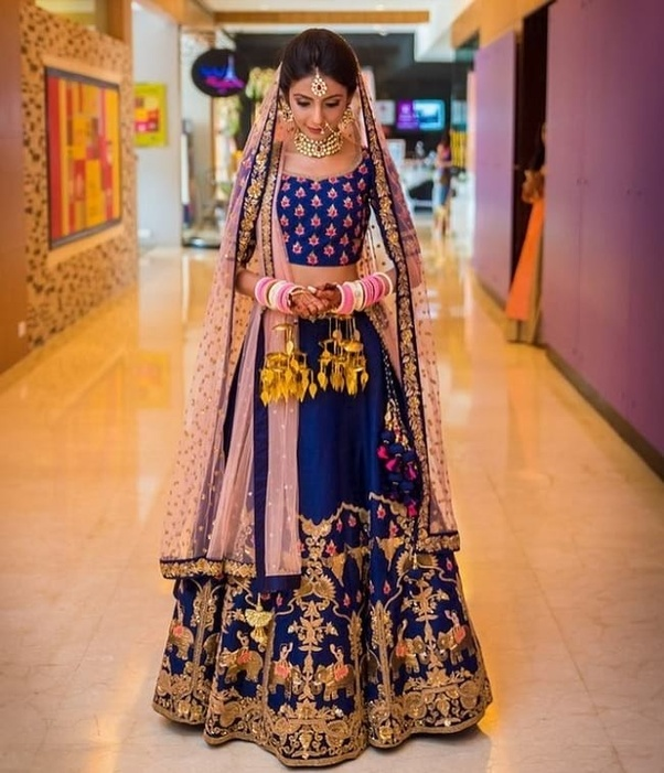 3169e0676b08 Indian women like to buy wedding lehenga online because they get more  choice in design and color with good discount.