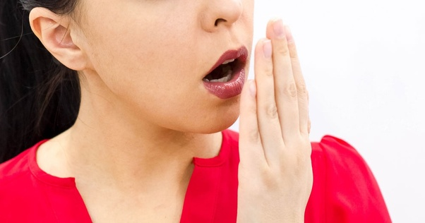 How can one get rid of bad breath due to wearing a dental bridge