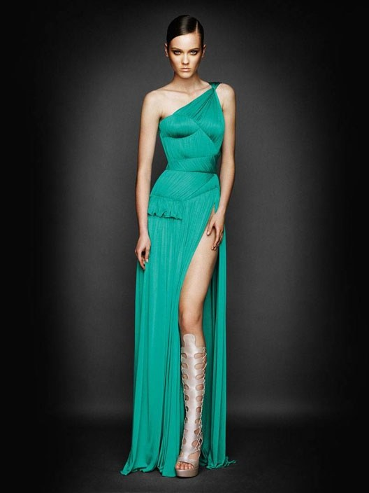 A Long Green Dress Worn With Pewter Colored Shoes