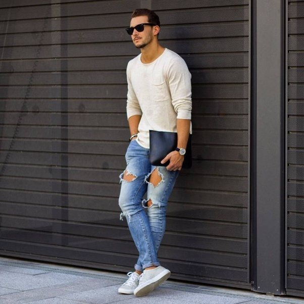 You can wear a nice white t-shirt with dark blue jeans, black t-shirt with  blue jeans, white and black striped t-shirt with blue jeans.