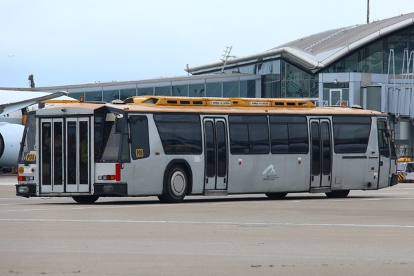 Why do airports use a special type of bus to transport passengers between gates and airplanes? Why don't they use the regular type of buses we see on the roads? - Quora