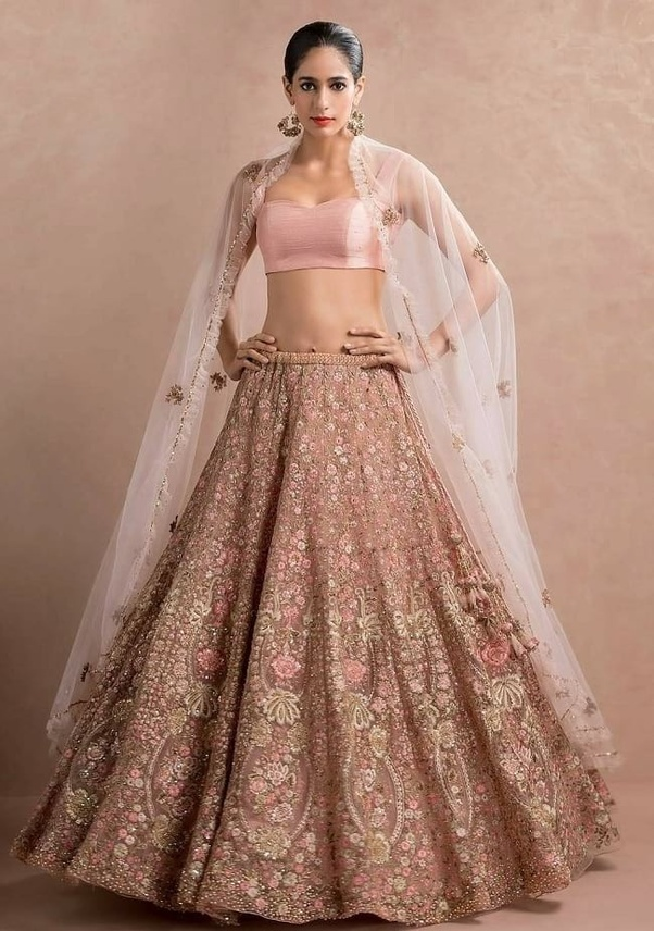 888ca802586 Indian women like to buy wedding lehenga online because they get more choice  in design and color with good discount.