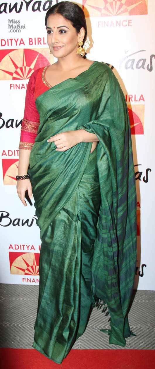 a6fd31c3ecae25 A red three quarter sleeve blouse looks great with green saree.