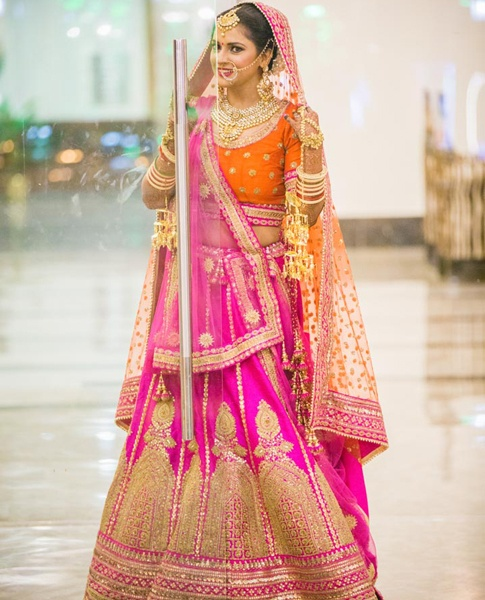 93b26232eeb1 The traditional wedding dress is a Saree or Lehenga. The brides are  gorgeously decorated head to toe. The color bride chosen for their dress is  mostly red ...
