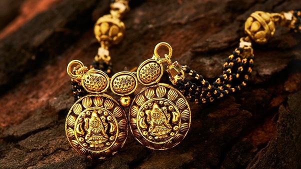 Why is a mangalsutra tied to a yellow thread? - Quora