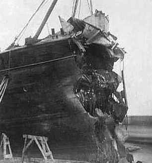 in which case just about any ship is capable of surviving  the forward  bulkheads are designed to keep the ship afloat if the bow is crushed like  this