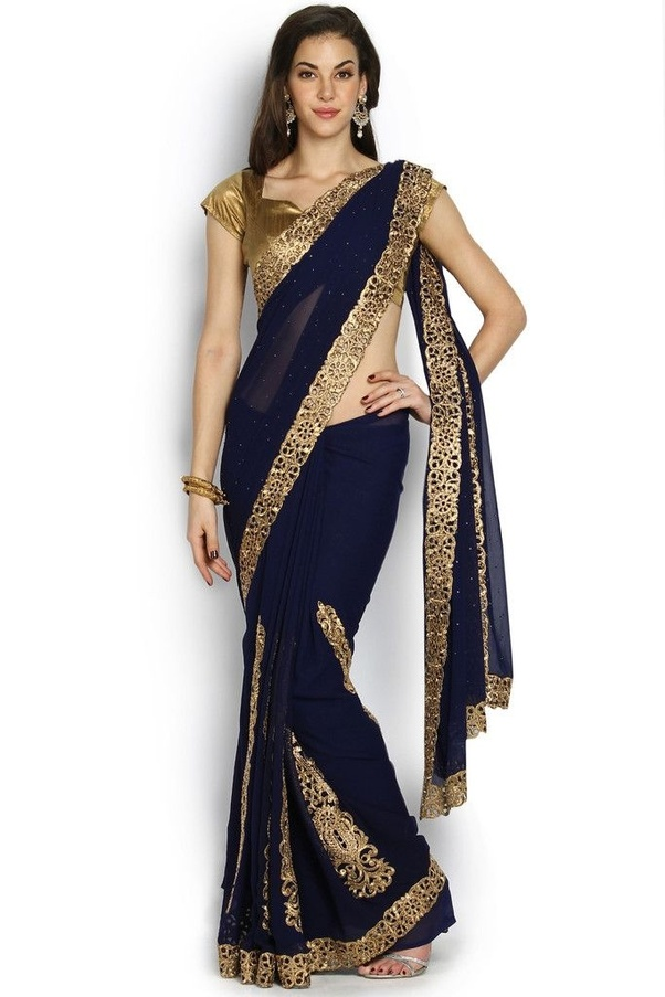 486dc3707fee6 Which color blouse will go with a navy blue saree with a golden or ...