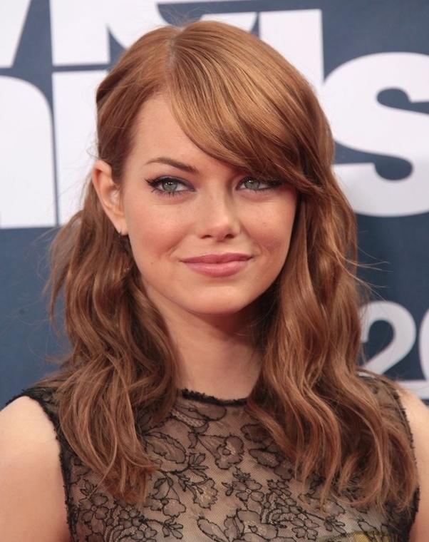 Blonde or brown hair with green eyes