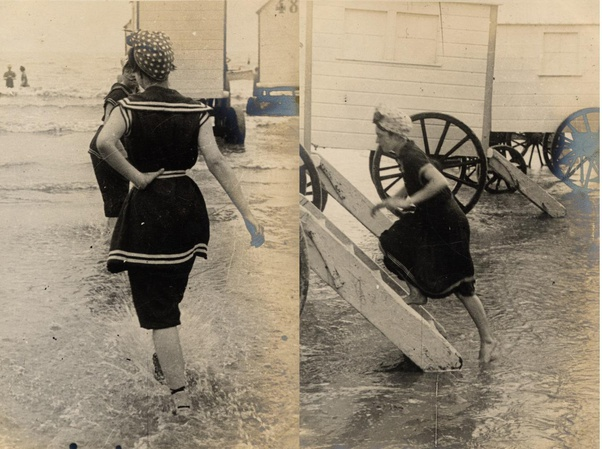 2 photos of the same woman in a sailor suit styled swimsuit (try saying that after a couple of gins) comprising a short-sleeved dress and knee-length bloomers. The first shows her entering the sea, the second shows her leaving the water and entering a beach cabin. The peplum of the dress portion appears to have lengthened slightly in the second photo.