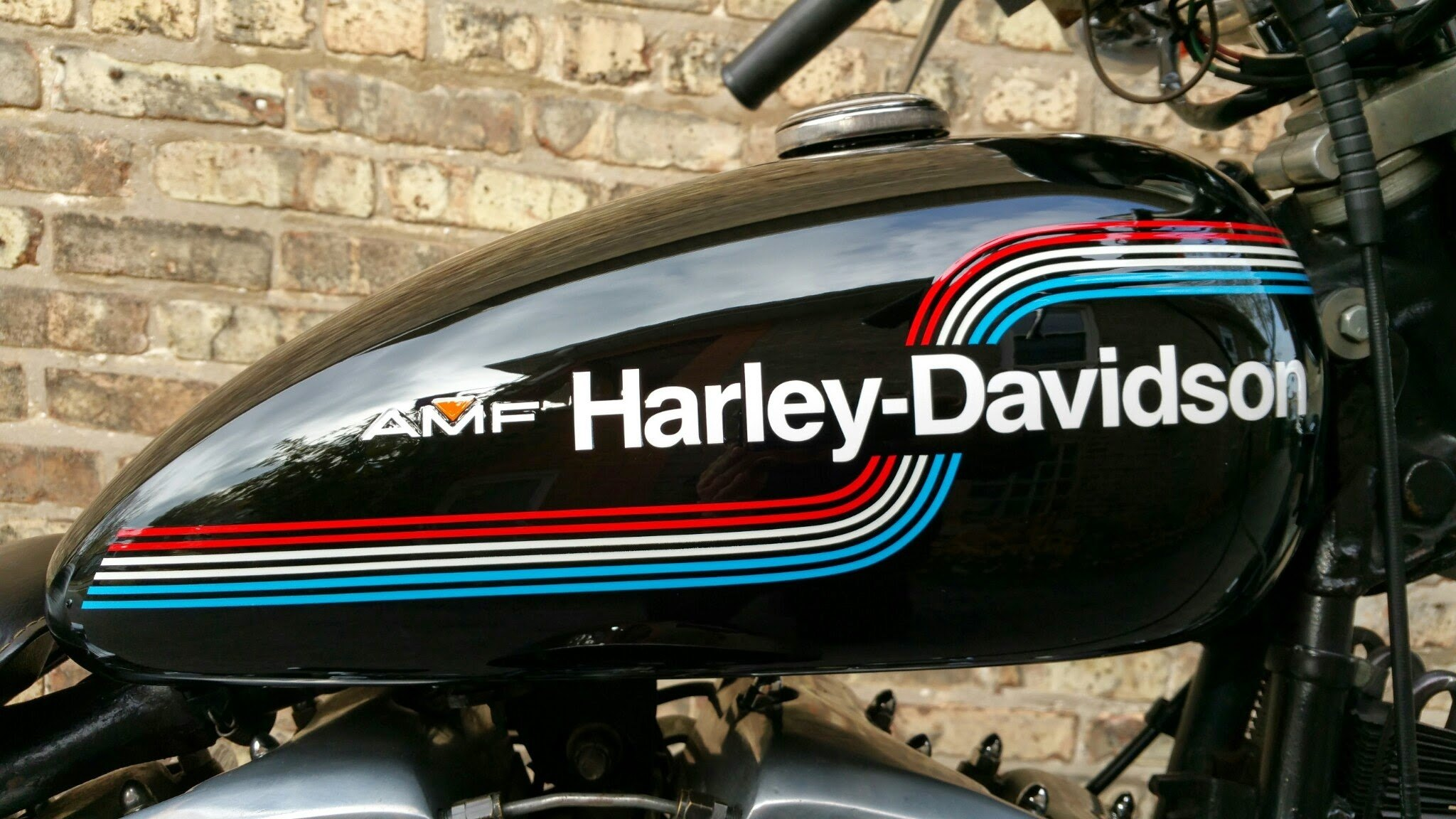 What years did AMF own Harley-Davidson motorcycles? What is the