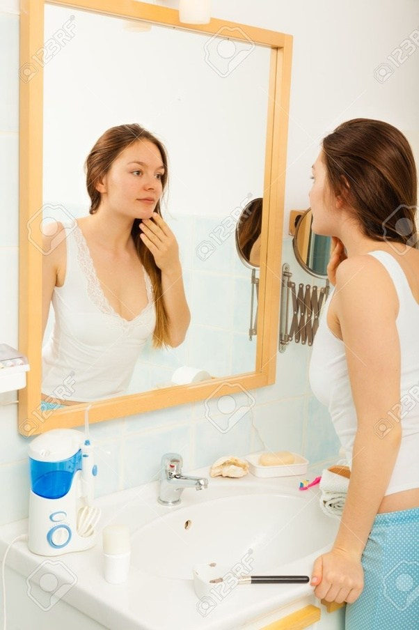 looking in mirror. Brilliant Mirror If Youu0027re Looking At A Bathroom Or Pocket Mirror Youu0027d Likely Get  Closer Thus Your Facial Structure Will Be More Apparent Face Is Lit In  Intended Looking In Mirror