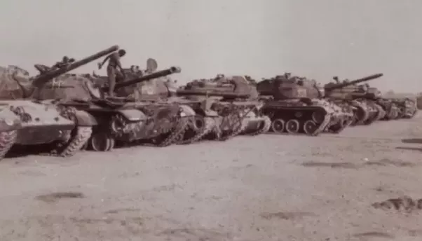 Image result for Destroyed or abandoned Pakistani Patton and Sherman tanks on display near Khem Karan