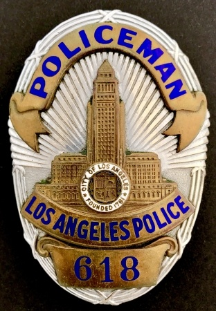Do police departments reuse badge numbers or are certain