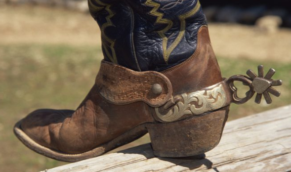 Why Do Cowboy And Cowgirl Boots Have Those Little Round Razors At