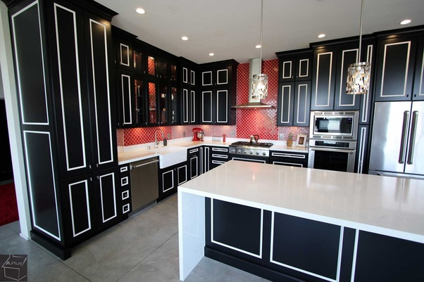 Dark Color Cabinets With White Lines And Counter Tops.