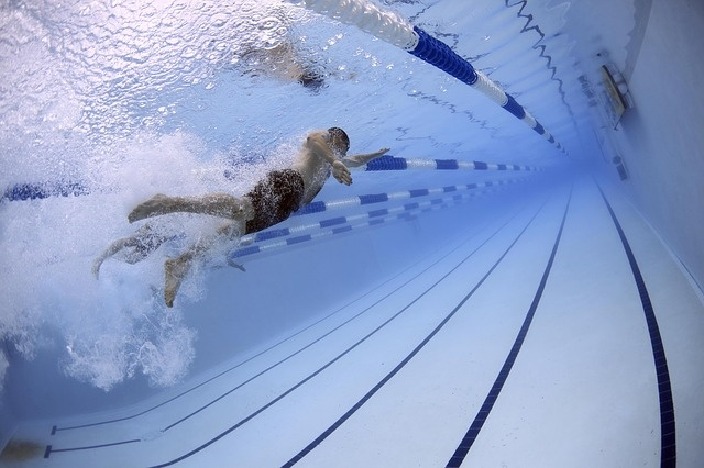 In a 50-meter pool, how many laps is a mile? - Quora