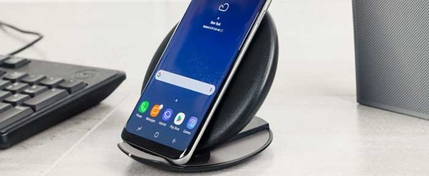 What specific wireless charger with stand is compatible with