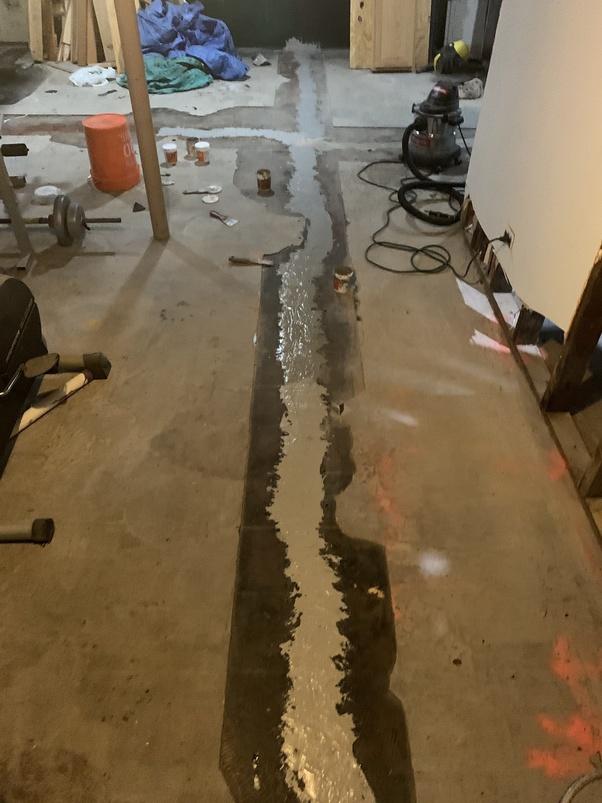 Can I pour concrete over linoleum/vinyl tiles to level the