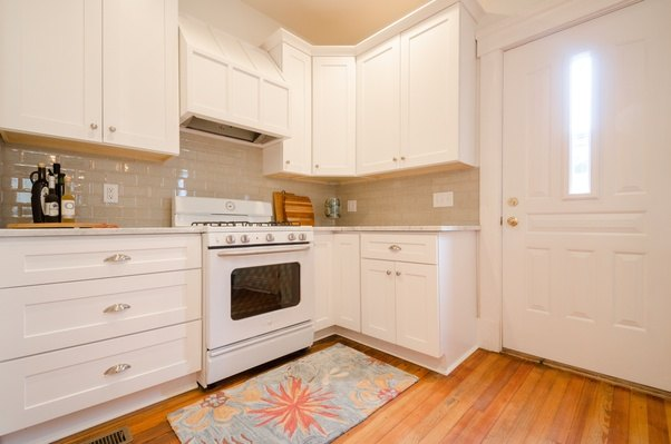 White Cabinets, White Counter, Beige Crackle Glass Subway Tile: