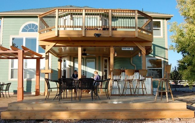 Decks can be ground level or higher and even second floor. I guess what makes it a deck vs a balcony or porch is that it is made of wood or trex. & What are the differences between a balcony and a porch? - Quora