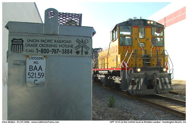What causes the railroad crossing lights to flash when there
