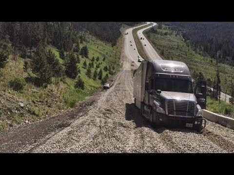 When going downhill, at what point should a tractor trailer