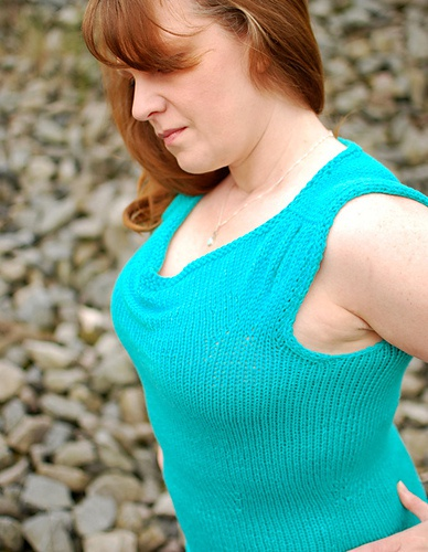 A woman in a sleeveless knitted top.