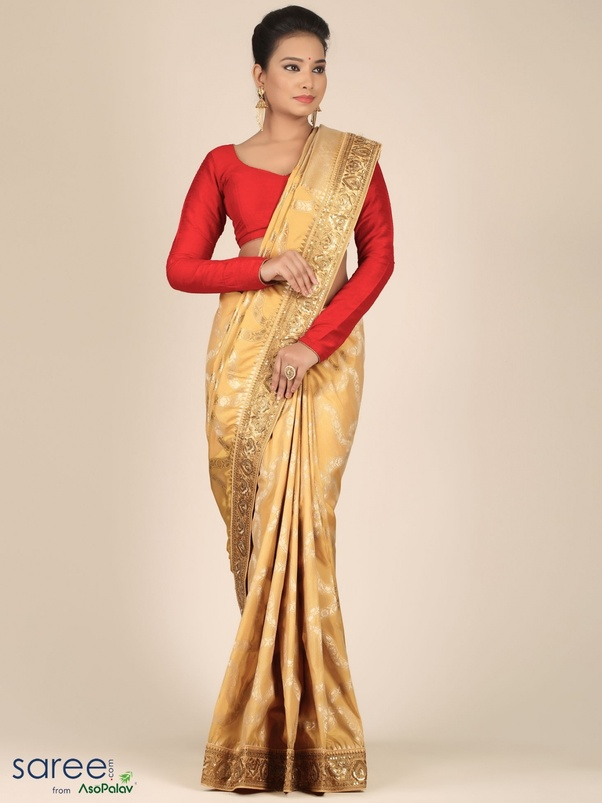 9d4aef134f1ba5 A silk sari or a silk suit with metallic tones of gold or with golden-beige  and adorned with shimmery laces and motifs would make a royal silhouette  for an ...