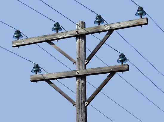 How are wires attached to telephone poles quora for Power line insulators glass