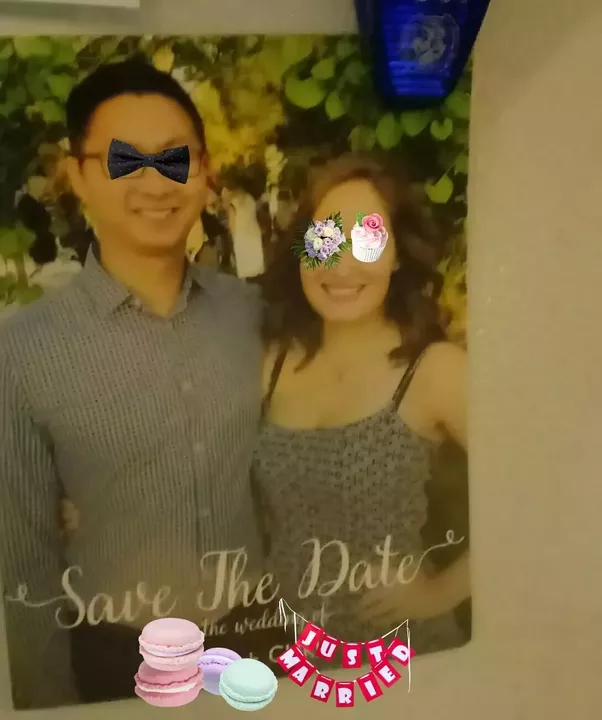A save the date for the wedding of our friends. Aside from the stickers I  put on for their privacy, you can see that he is Asian and she is white.