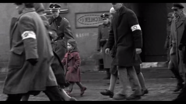 That little girl in red coat shown in a scene depicting the liquidation of a ghetto if you watch the movie the girl will definitely catch your eye in the