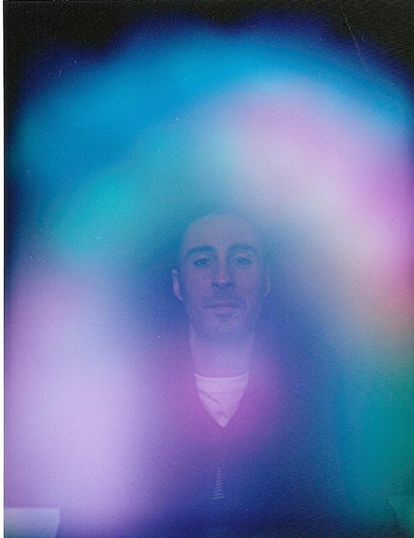 Kirlian photo shows a leaf cut In half & displays an aura of