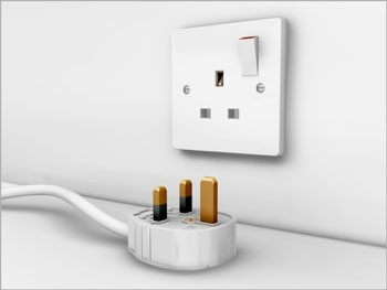 they use 220 volts and 50 hz  they are exactly the same as the plugs and  sockets as you would find in the uk