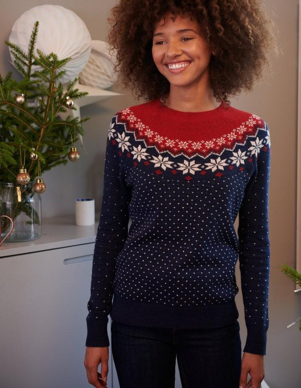 A woman wearing a yoked sweater of the icelandic lopapeysa type, but with swedish motifs.