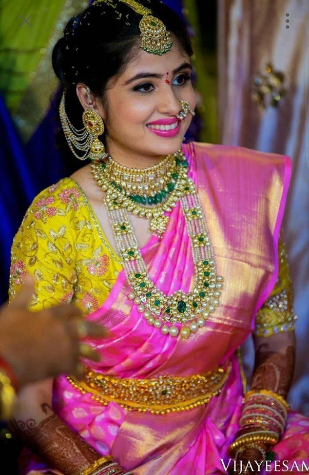 Look 1: The Grand Look - Bright sari colours combined with Heavy jewelry, with light makeup and not too detailed designs, to balance the look.