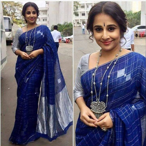 681961ba4ce6c5 Classic black silk blouse: black blouse with blue saree looks timeless!