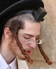 Could someone from the Jewish Orthodox community explain the male and female hair and hatstyles ...